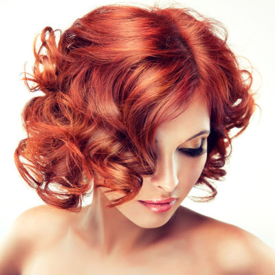 coloration-red with curly hair